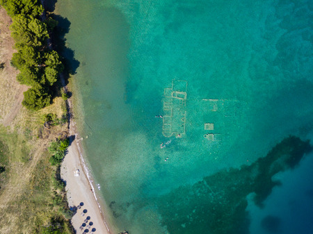 Aerial drone birds eye view photo of tourists snorkeling above old Sunken City of Epidauros, Greece Stock Photo