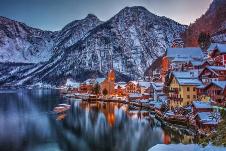 Winter evening fairytale town Hallstadt near the lake.