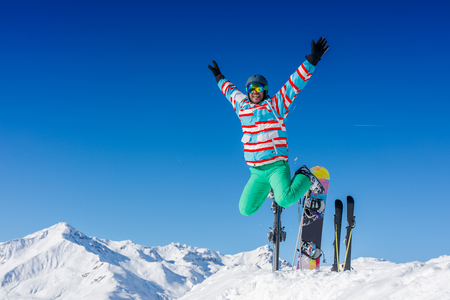 Man skier jumping and having fun in the winter ski resort.