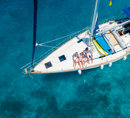 Top view of Family with adorable kids resting on yacht