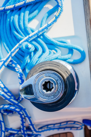 Sailboat winch and rope yacht detail. Yachting Reklamní fotografie