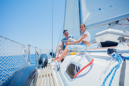 Father with adorable daughter resting on yacht