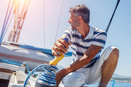 Young man sailing yacht. Holidays, people, travel Stock Photo