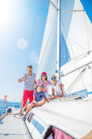 Family with adorable kids resting on yacht