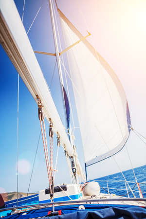Sailing. Ship yachts with white sails in the open Sea.