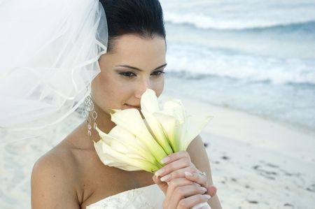 Bride on beach with her bouquet