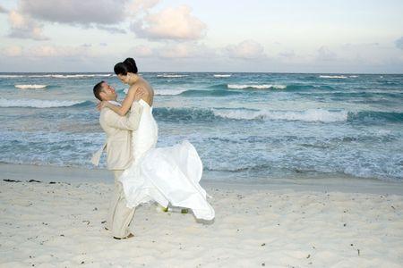 Brige and groom celebrating on the beach