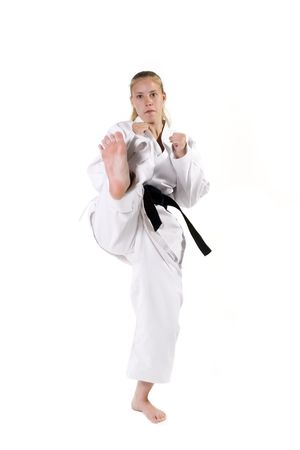 Female Third Degree Black Belt throwing a front snap kick.
