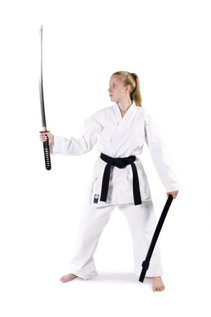 Female Third Degree Black Belt with Katana.