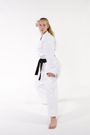 martial arts woman: Female Third Degree Black Belt, low block tiger claw.