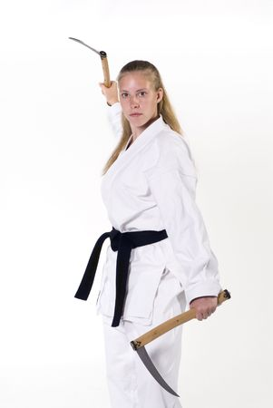 Female Third Degree Black Belt with kamas.