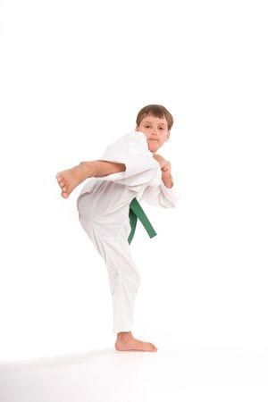 7yo Green Belt chambering for a round kick Banco de Imagens