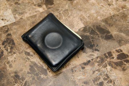 Condom ring in mens wallet.