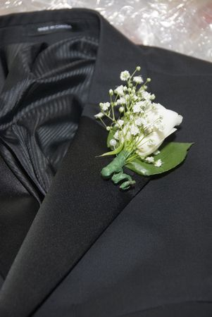 Grooms tuxedo with boutonniere on his wedding day.