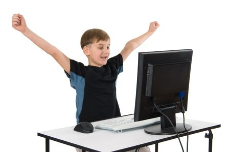 Boy on computer with cordless mouse and keyboard.