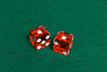 Red Casino Dice with Snake Eyes showing.