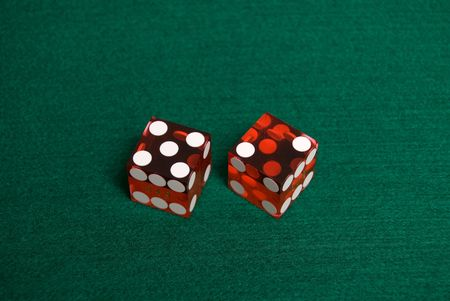 Red Casino Dice with Lucky 7 showing.