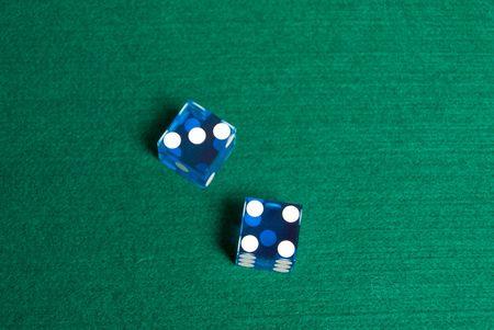 Blue Casino Dice on green felt showing Seven.