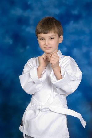 Little white belt with his fists up. 版權商用圖片