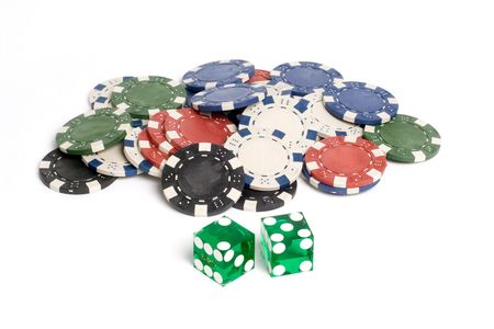 Green casino dice with lucky 7 showing with chips