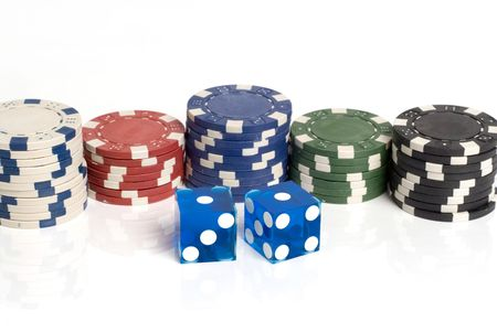 Blue casino dice with snake eyes showing with chips