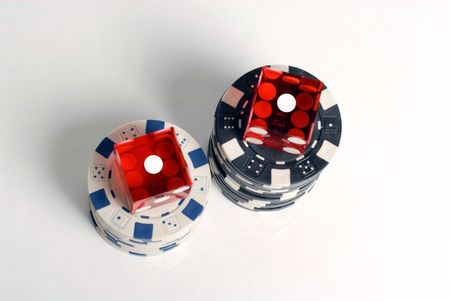 Red Casino Dice with Snake Eyes showing with chips Stok Fotoğraf