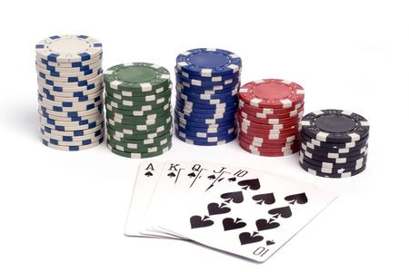 A royal straight flush hand with colored poker chips. Banco de Imagens