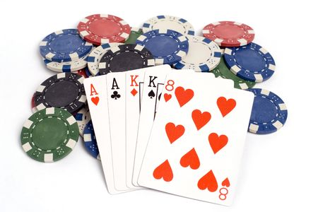 Two pair poker hand with colored poker chips.
