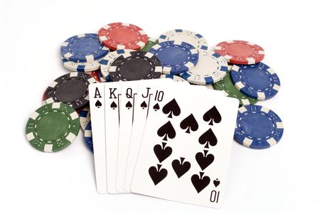 straight flush: A royal straight flush hand with colored poker chips. Stock Photo