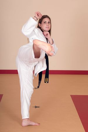 martial arts woman: Second Degree Black Belt Woman Stock Photo