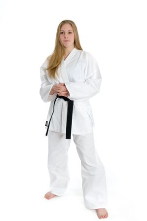 Female Martial Artist in white gee with black belt