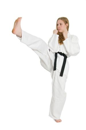 martial arts woman: Black belt female martial artist doing front kick.