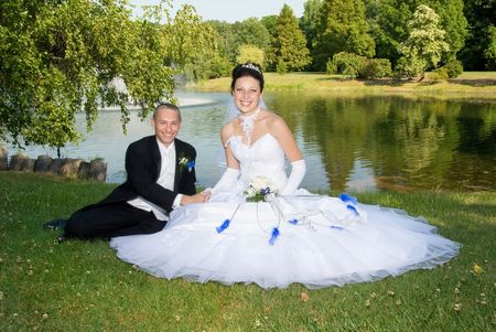 Beautiful bride with groom at the park.