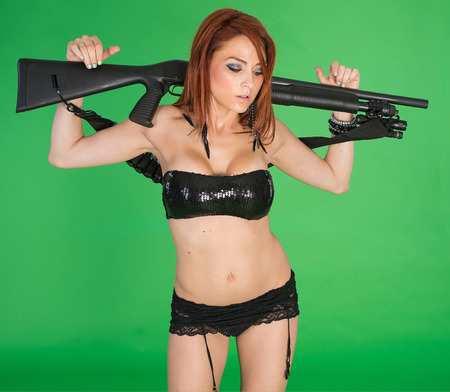 redhead lingerie: Hot redhead in lingerie with shotgun