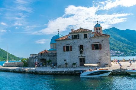MONTENEGRO - JUNE 042017. Tourists sailed on a yacht to the island of Gospa od Skrpela in the Boka Bay of Kotor.