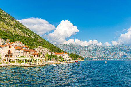 MONTENEGRO - JUNE 042017. Tourists sailed on the yacht past the city of Perast in the Boka Bay of Kotor.