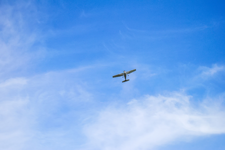 a small single-engine plane in the sky