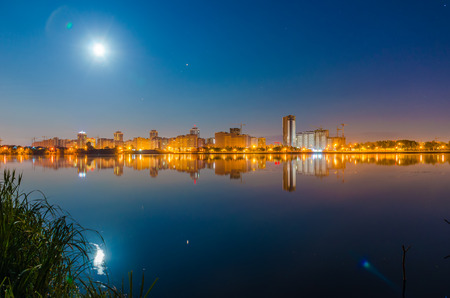Reflection of the night city on the water surface.