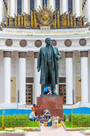 RUSSIA, MOSCOW - JULY 12/2016: Workers rebuild a monument to Soviet leader Ulyanov Lenin on the territory of the Exhibition of Economic Achievements.
