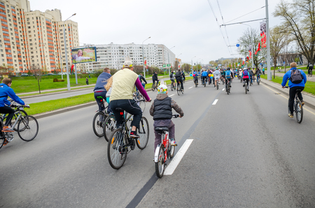 BELARUS, MINSK - APRIL 30/2016: On the central streets of Minsk hosted the annual bicycle carnival in which everyone participated. Reklamní fotografie - 115969262