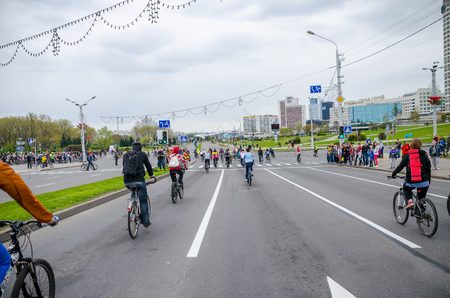 BELARUS, MINSK - APRIL 30/2016: On the central streets of Minsk hosted the annual bicycle carnival in which everyone participated. Reklamní fotografie - 115969373