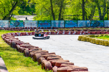 UKRAINE, DNEPROPETROVSK - APRIL 292017: in the city park of Chkalov there were karting competitions among children.