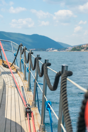 Mooring is fixed on the rails while the yacht is moving. Montenegro, the Adriatic Sea.