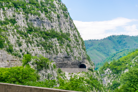A picturesque journey along the roads of Montenegro among rocks and tunnels. The river Moraca.