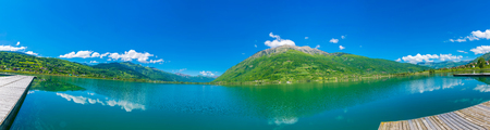 A picturesque mountain lake is located in a valley among the mountains.