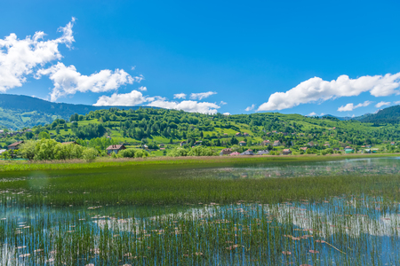 A large mountain lake in a picturesque valley. Stock fotó