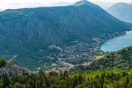 A view of the ancient city of Kotor and the Boka Kotorska bay from the top of the mountain. Imagens