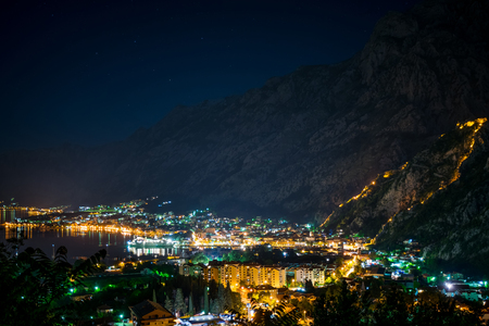 The lights of the night city in the old fjord. Stock Photo