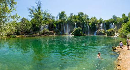 BOSNIA AND HERZEGOVINA, LYUBUSHKI - JUNE 012017: tourists rest and swim in the picturesque waterfall. Redakční