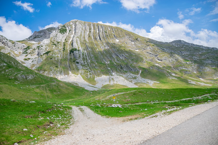 A winding road runs through the picturesque mountains.